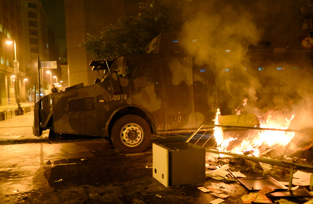 Description of . An armoured vehicle of the riot police is seen during clashes in Rio de Janeiro's downtown, on June 17, 2013. Tens of thousands of people took to the streets of major Brazilian cities protesting the billions of dollars spent on the Confederations Cup --and preparations for the upcoming World Cup-- and against the hike in mass transit fares.  CHRISTOPHE SIMON/AFP/Getty Images