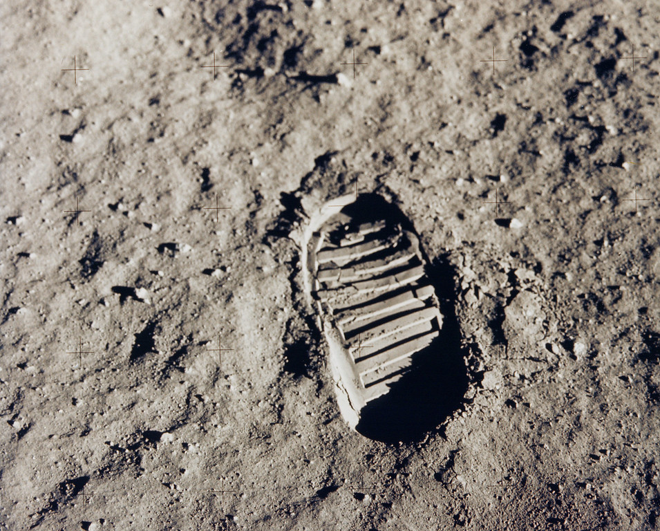 Description of . This NASA handout picture taken on July 20, 1969, shows one of the first steps, astronaut Buzz Aldrin\'s bootprint, taken on the Moon as part of the Apollo 11 mission. With one small step off a ladder, Neil Armstrong became the first human to set foot on the moon on July 20, 1969, before the eyes of hundreds of millions of awed television viewers worldwide. With that step, he placed mankind\'s first footprint on an extraterrestrial world and gained instant hero status. Joined by fellow astronaut Buzz Aldrin, Armstrong spent about two and a half hours exploring the landscape around the landing site.   AFP PHOTO / NASA