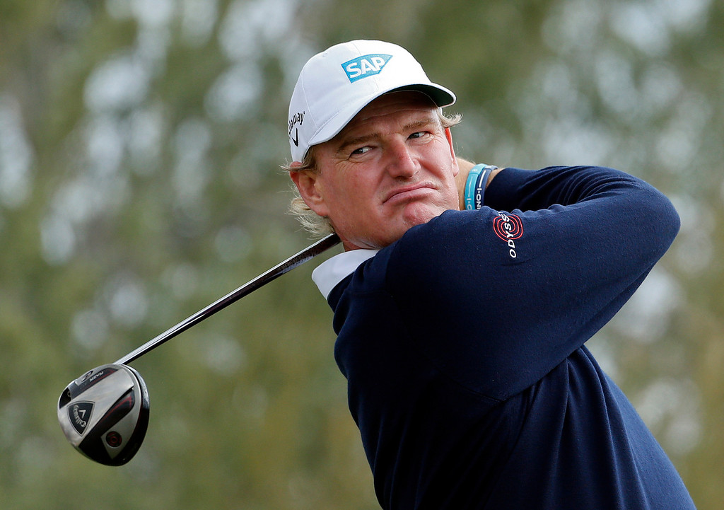 Description of . South Africa\'s Ernie Els tees off the 15th hole against Fredrik Jacobson, of Sweden, in the first round during the Match Play Championship golf tournament, Thursday, Feb. 21, 2013, in Marana, Ariz. Jacobson won 1 up. (AP Photo/Ross D. Franklin)