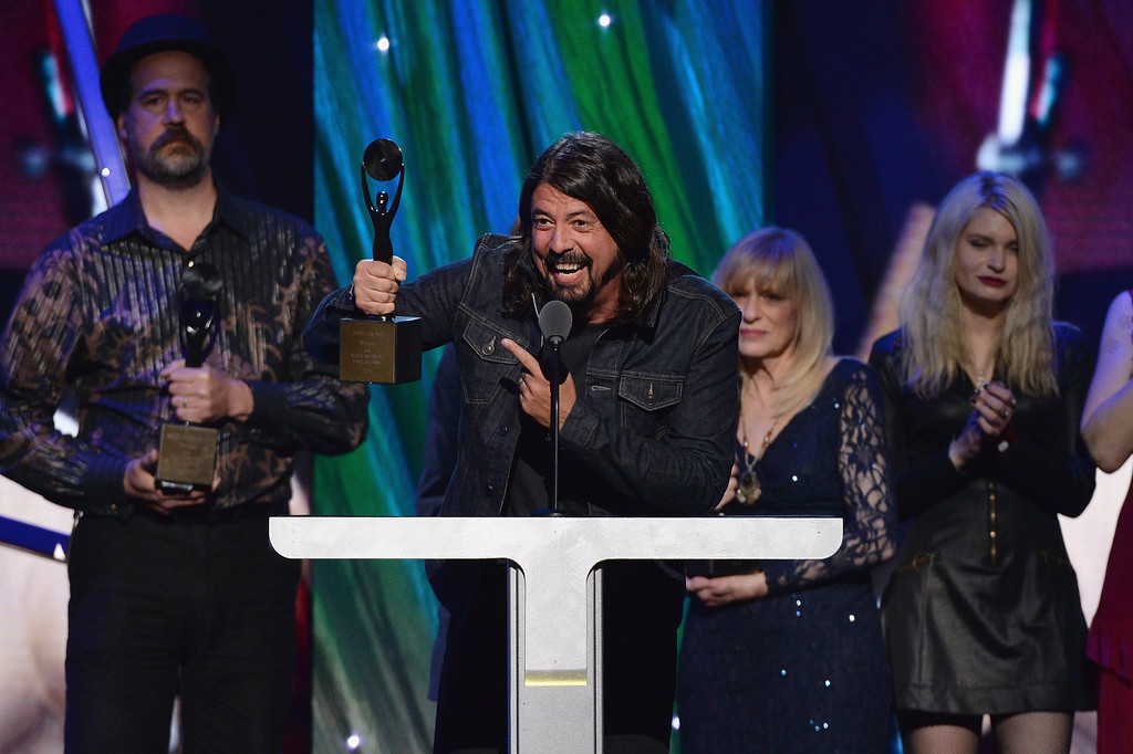 Description of . Inductee Dave Grohl (C) speaks onstage at the 29th Annual Rock And Roll Hall Of Fame Induction Ceremony at Barclays Center of Brooklyn on April 10, 2014 in New York City.  (Photo by Larry Busacca/Getty Images)