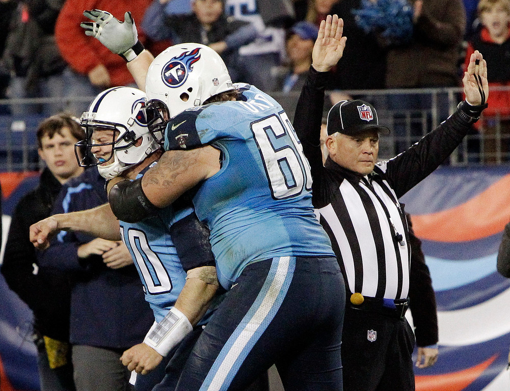 Description of . Tennessee Titans quarterback Jake Locker (10) is hugged by tackle Mike Otto (66) after running 13 yards for a touchdown against the New York Jets in the third quarter of an NFL football game, Monday, Dec. 17, 2012, in Nashville, Tenn. (AP Photo/Wade Payne)