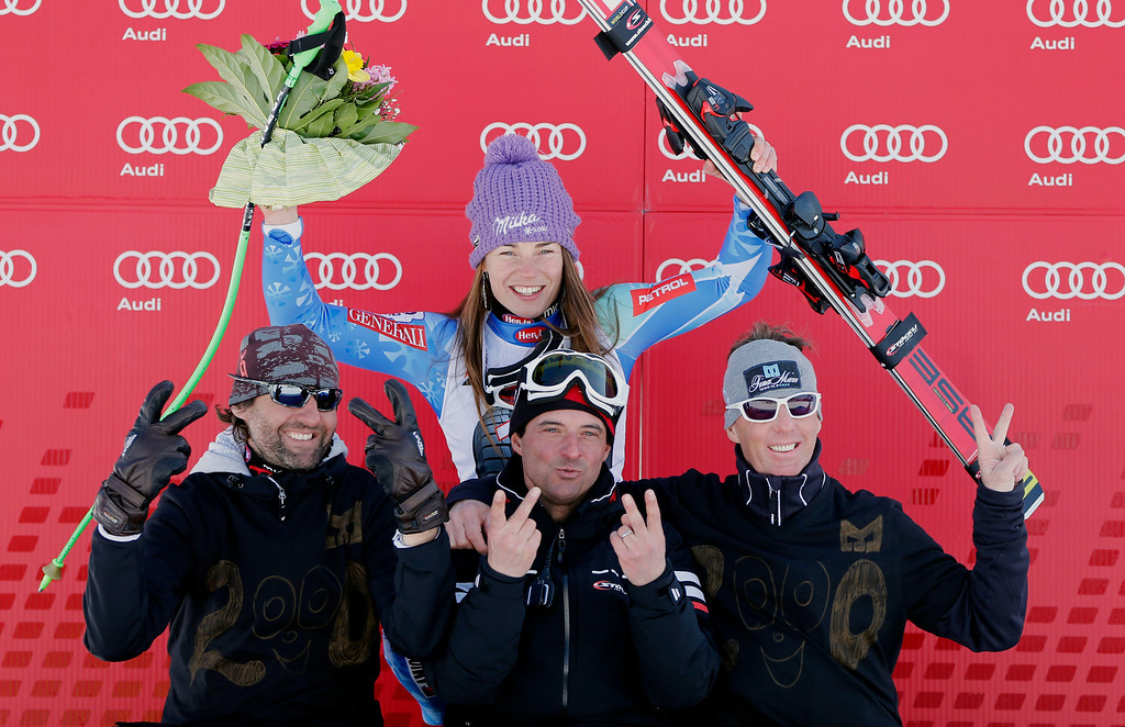 Description of . Slovenia\'s Tina Maze, top center, celebrates on the podium with her team members after winning an alpine ski, women\'s World Cup downhill, in Garmisch-Partenkirchen, Germany, Saturday, March 2, 2013. (AP Photo/Marco Trovati)