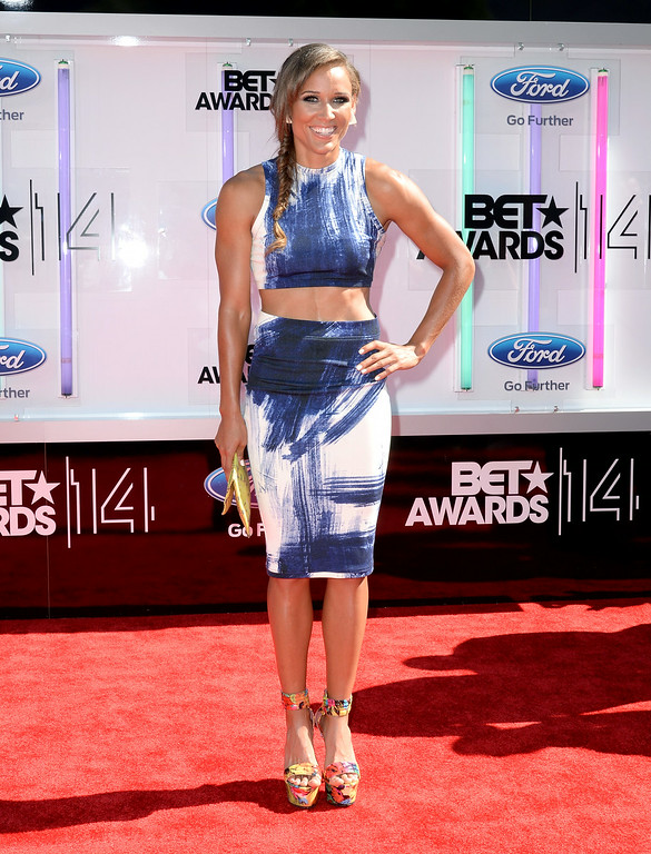 Description of . Athlete Lolo Jones attends the BET AWARDS '14 at Nokia Theatre L.A. LIVE on June 29, 2014 in Los Angeles, California.  (Photo by Earl Gibson III/Getty Images for BET)