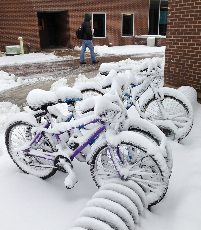 Description of . Bicycles are parked outside Hamilton Hall dorms are covered in snow after a storm passed the area, Wednesday, March 6, 2013 at Wright State University in Dayton, Ohio.   The National Weather Service has lifted winter storm warnings across Ohio, after a late-season storm dumped a half foot of snow or more on much of the state. (AP Photo/The Dayton Daily News, Ty Greenlees)