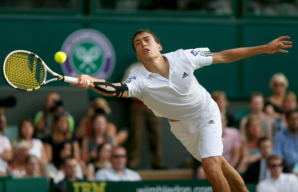 Description of . Jerzy Janowicz of Poland hits a return to Andy Murray of Britain during their men\'s semi-final tennis match at the Wimbledon Tennis Championships, in London July 5, 2013.   REUTERS/Stefan Wermuth
