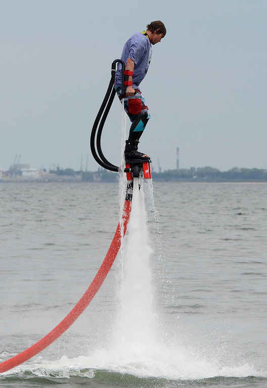 Description of . A man with hydro shoes flies over the water at a beach on the Baltic Sea in Sopot on June 7, 2012 on the eve of the Euro 2012 championships opening football match.       AFP PHOTO / PATRIK STOLLARZPATRIK STOLLARZ/AFP/GettyImages
