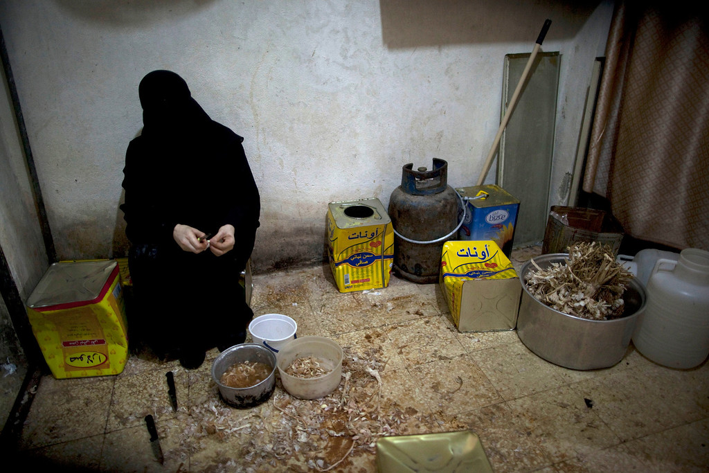Description of . A Syrian woman cooks an Iftar meal for poor people during the second day of the Muslim holy month of Ramadan in the Bustan al-Qasr district of Aleppo on July 11, 2013. Syria's ruling Baath party has replaced its top leadership in a surprise move, while UN head Ban Ki-Moon called on all parties in the war to observe a truce during the Muslim holy month of Ramadan. JM LOPEZ/AFP/Getty Images