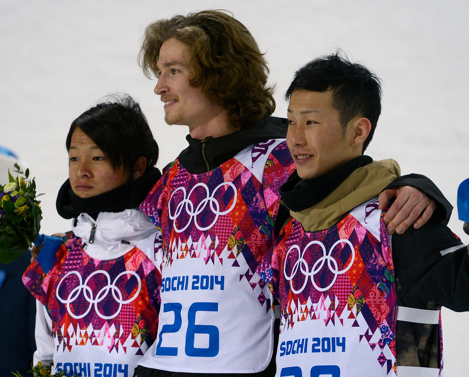 Description of . Silver medalist Japan\'s Ayumu Hirano, gold medalist Switzerland\'s Iouri Podladtchikov and bronze medalist Japan\'s Taku Hiraoka pose during the flower ceremony for Men\'s Halfpipe at the Rosa Khutor Extreme Park for the 2014 Winter Olympics in Krasnaya Polyana, Russia, on Tuesday, Feb. 11, 2014.  (Nhat V. Meyer/Bay Area News Group)