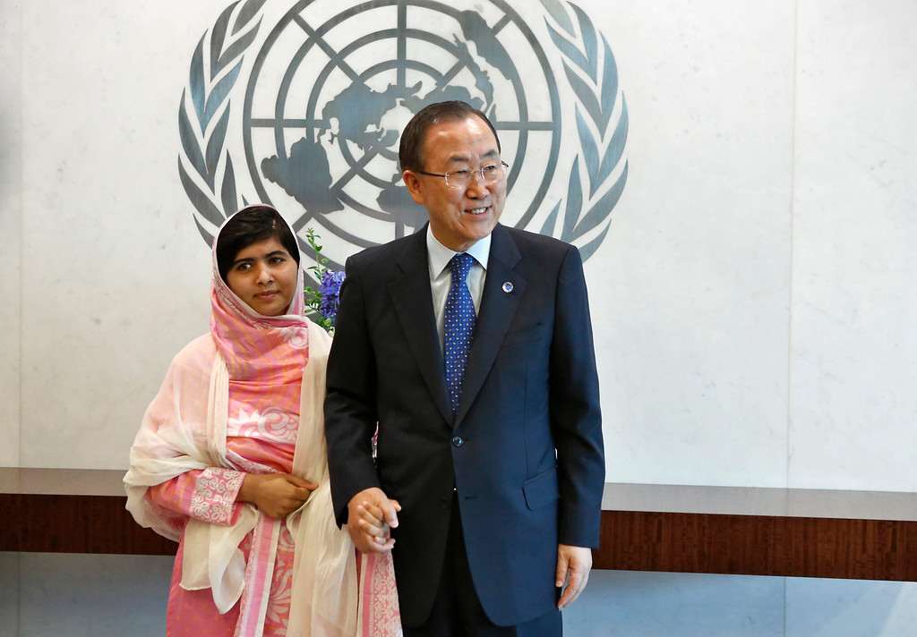 Description of . Malala Yousafzai stands next to U.N. Secretary-General Ban Ki-moon (R) before giving her first speech since the Taliban in Pakistan tried to kill her for advocating education for girls, at the United Nations Headquarters in New York, July 12, 2013. Wearing a pink head scarf, Yousafzai told Ban and nearly 1,000 students from around the world attending a Youth Assembly at U.N. headquarters in New York that education was the only way to improve lives. REUTERS/Brendan McDermid