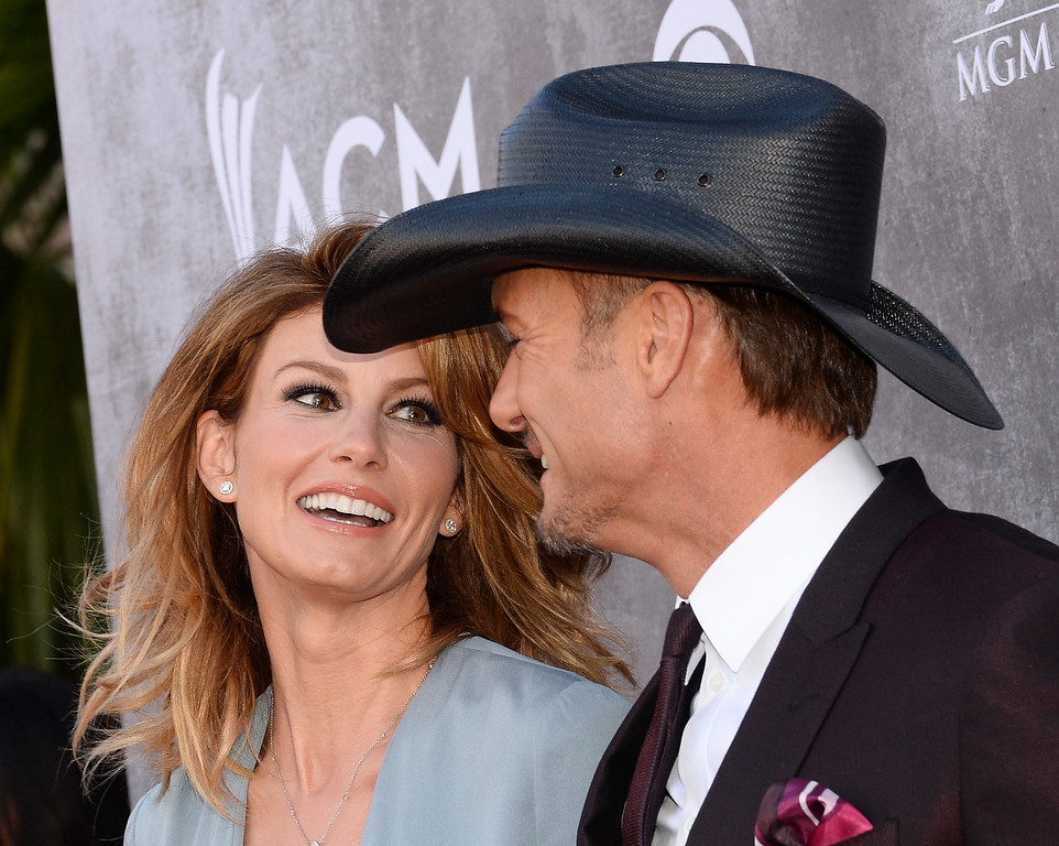 Description of . Faith Hill, left, and Tim McGraw arrive at the 49th annual Academy of Country Music Awards at the MGM Grand Garden Arena on Sunday, April 6, 2014, in Las Vegas. (Photo by Al Powers/Powers Imagery/Invision/AP)