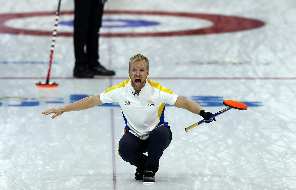 Description of . Sweden\'s Niklas Edin (C) reacts during the men\'s curling round robin session 3 match between Sweden and Canada at the Ice Cube curling centre in Sochi on February 11, 2014 during the 2014 Sochi winter Olympics.   ADRIAN DENNIS/AFP/Getty Images