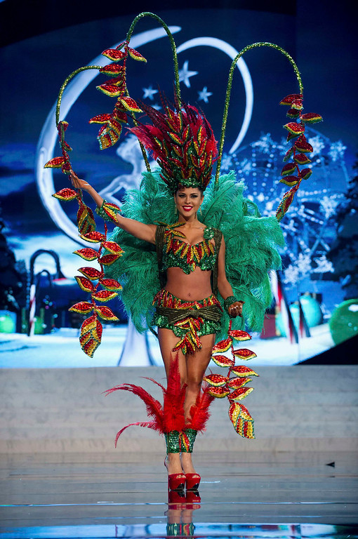 Description of . Miss Bolivia Yessica Mouton performs onstage at the 2012 Miss Universe National Costume Show at PH Live in Las Vegas, Nevada December 14, 2012. The 89 Miss Universe Contestants will compete for the Diamond Nexus Crown on December 19, 2012. REUTERS/Darren Decker/Miss Universe Organization L.P./Handout