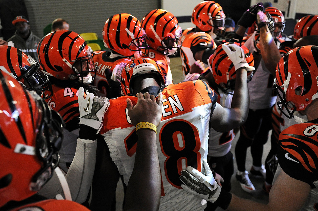 Description of . Wide receiver A.J. Green #18 of the Cincinnati Bengals and teammates have a moment to themselves before playing the Baltimore Ravens at M&T Bank Stadium on November 10, 2013 in Baltimore, Maryland. (Photo by Patrick Smith/Getty Images)