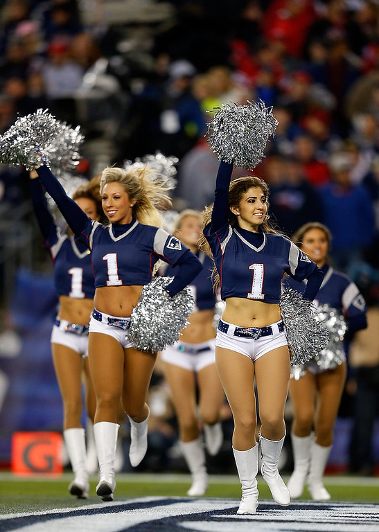 Description of . Cheerleaders for the Houston Texans perform during the 2013 AFC Divisional Playoffs game at Gillette Stadium on January 13, 2013 in Foxboro, Massachusetts.  (Photo by Jim Rogash/Getty Images)