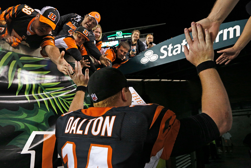 Description of . Cincinnati Bengals quarterback Andy Dalton leaves the field after the Bengals defeated the Pittsburgh Steelers 20-10 in an NFL football game, Monday, Sept. 16, 2013, in Cincinnati. (AP Photo/David Kohl)