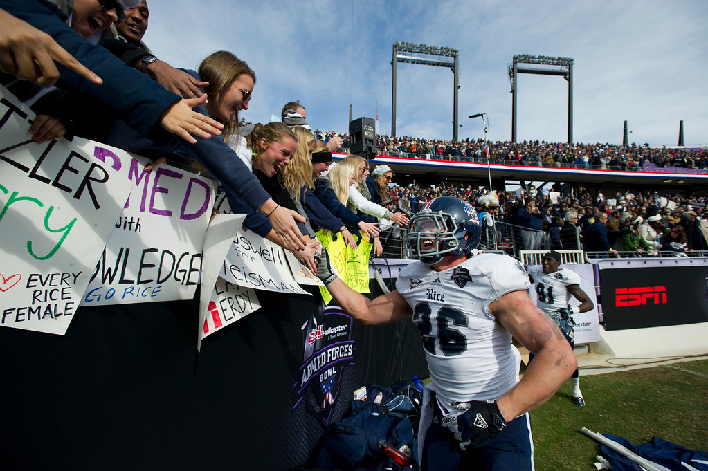 Description of . Turner Petersen #26 of the Rice Owls celebrates with fans after defeating the Air Force Falcons on December 29, 2012 in the Bell Helicopter Armed Forces Bowl at Amon G. Carter Stadium in Fort Worth, Texas.  (Photo by Cooper Neill/Getty Images)