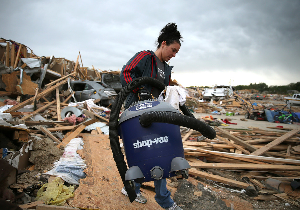 Description of . Michelle McGee removes belonings from her home that was destroyed by a tornado on Sunday, April 29, 2014 in Vilonia, Arkansas.  (Photo by Mark Wilson/Getty Images)
