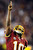 Washington Redskins quarterback Robert Griffin III points skyward after throwing a touchdown pass to wide receiver Pierre Garcon during the second half of an NFL football game against the New York Giants in Landover, Md., Monday, Dec. 3, 2012. (AP Photo/Nick Wass)