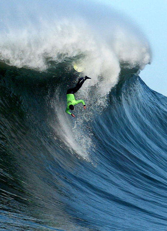 Description of . Mike Brumet of Santa Cruz goes head first over the falls during a large set during the annual Mavericks Surf Contest. (Shmuel Thaler/Santa Cruz Sentinel)