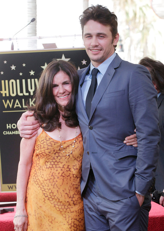 Description of . Actor James Franco poses with his mother Betsy Lou Franco after his star was unveiled on the Hollywood Walk of Fame, in Hollywood March 7, 2013. REUTERS/Fred Prouser