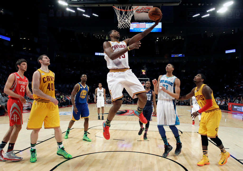 Description of . Cleveland Cavaliers Tristan Thompson (13) goes in for a dunk during the first half of the NBA BBVA Rising Star Challenge basketball game in Houston, Texas, February 15, 2013. REUTERS/Eric Gay/Pool