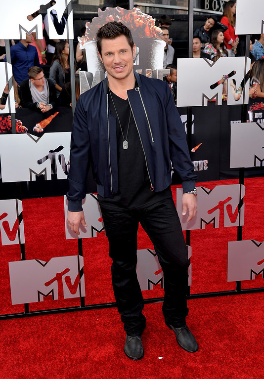 Description of . TV personality Nick Lachey attends the 2014 MTV Movie Awards at Nokia Theatre L.A. Live on April 13, 2014 in Los Angeles, California.  (Photo by Michael Buckner/Getty Images)