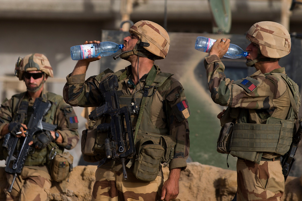 Description of . French soldiers drink water after a  patrol in a street of Gao, on April 5, 2013. The United Nations expressed concern over reprisal attacks against ethnic Tuaregs and Arabs in Mali, where a French-led intervention recently routed Islamist rebels.  JOEL SAGET/AFP/Getty Images
