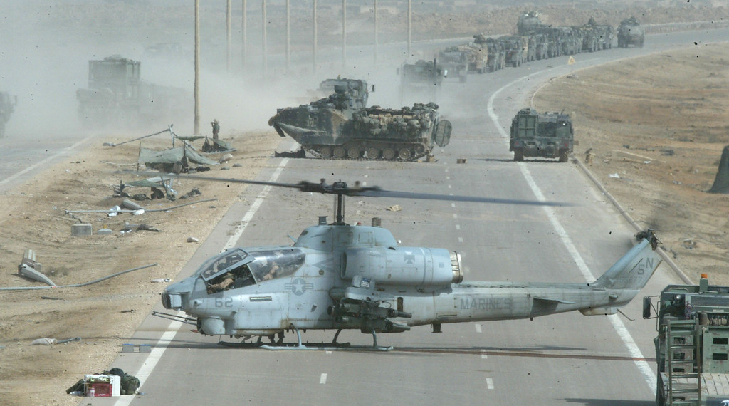 Description of . A U.S. Marine Cobra helicopter prepares to take off after being repaired April 5, 2003 in central Iraq. The Marines continued to sweep through the country looking for enemy forces. (Photo by Joe Raedle/Getty Images)