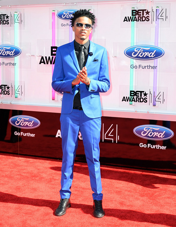 Description of . Singer August Alsina attends the BET AWARDS '14 at Nokia Theatre L.A. LIVE on June 29, 2014 in Los Angeles, California.  (Photo by Earl Gibson III/Getty Images for BET)