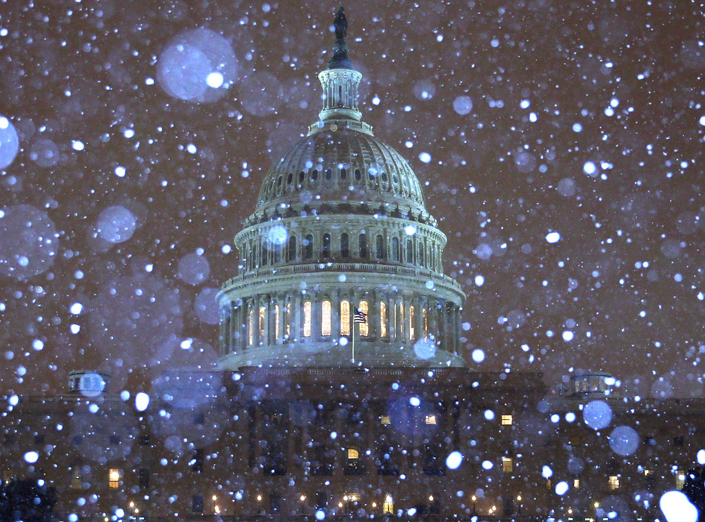 Description of . Snow falls in front of the U.S. Capitol building on February 13, 2014 in Washington, DC. The east coast was hit with a winter snow storm with the Washington area expecting up to 8 inches of snow before it ends.  (Photo by Mark Wilson/Getty Images)