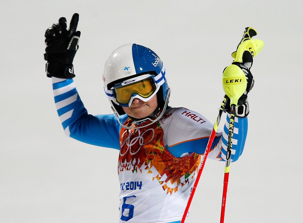 Description of . Finland's Tanja Poutiainen gestures after finishing the second run of the women's slalom at the Sochi 2014 Winter Olympics, Friday, Feb. 21, 2014, in Krasnaya Polyana, Russia. (AP Photo/Christophe Ena)