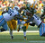 Ryan Grant #25 of the Green Bay Packers runs against DaJohn Harris #96 (L) and Kamerion Wimbley #95 of the Tennessee Titans at Lambeau Field on December 23, 2012 in Green Bay, Wisconsin. (Photo by Jonathan Daniel/Getty Images)