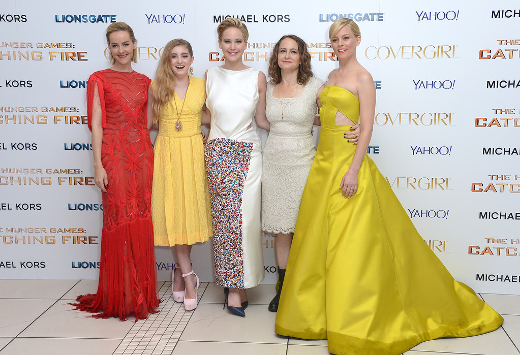 Description of . From left, actresses Jena Malone, Willow Shield, Jennifer Lawrence, producer Nina Jacobson and actress Elizabeth Banks pose for photographers at the World Premiere of 'The Hunger Games: Catching Fire', on Monday Nov. 11, 2013, in Leicester Square, London. 'Catching Fire' is the second installment in 'The Hunger Games' trilogy. (Photo by Jon Furniss/Invision/AP)