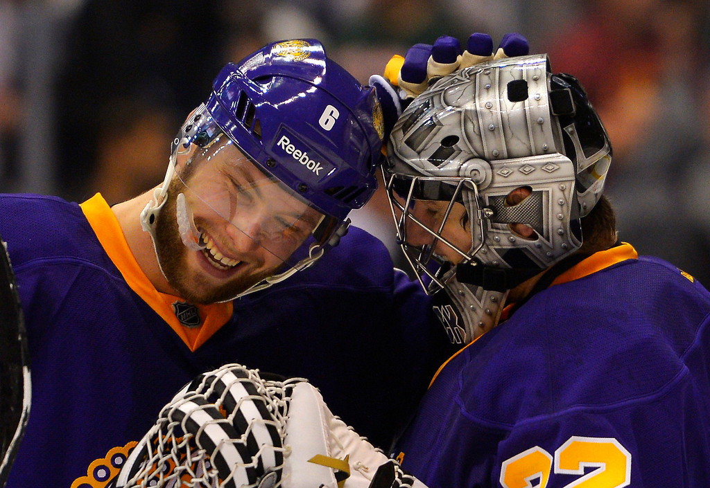 Description of . Los Angeles Kings defenseman Jake Muzzin, left, congratulates goalie Jonathan Quick after their NHL hockey game against the Colorado Avalanche, Saturday, Feb. 23, 2013, in Los Angeles. The Kings won 4-1.  (AP Photo/Mark J. Terrill)