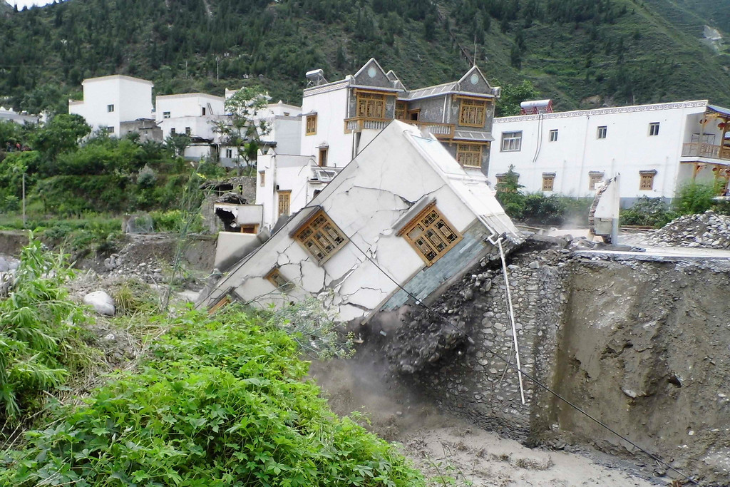 Description of . A house is seen damaged after a landslide in Aba Tibetan and Qiang Autonomous Prefecture, Sichuan Province, July 11, 2013. China braced on Friday for the impact of Typhoon Soulik as the toll of dead and missing from torrential rain across a broad swathe of China climbed beyond 200. Picture taken July 11, 2013. REUTERS/Stringer