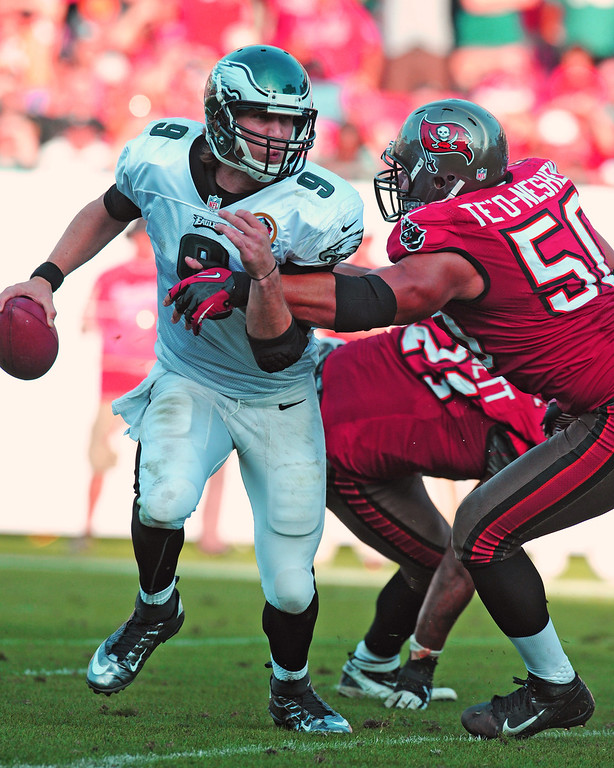 Description of . TAMPA, FL - DECEMBER 9: Quarterback Nick Foles #9 of the Philadelphia Eagles runs away from linebacker Daniel Te\'o-Nesheim #50 of the Tampa Bay Buccaneers December 9, 2012 at Raymond James Stadium in Tampa, Florida.  The Eagles won 23 - 21. (Photo by Al Messerschmidt/Getty Images)
