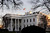 A U.S. flag flies at half-staff at the White House in Washington December 14, 2012. A tearful President Barack Obama expressed 