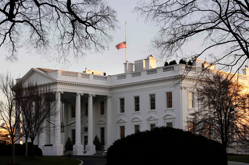 Description of . A U.S. flag flies at half-staff at the White House in Washington December 14, 2012. A tearful President Barack Obama expressed