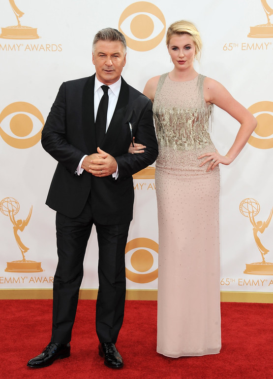 Description of . Alec Baldwin, left, and his daughter Ireland Baldwin arrive at the 65th Primetime Emmy Awards at Nokia Theatre on Sunday Sept. 22, 2013, in Los Angeles.  (Photo by Jordan Strauss/Invision/AP)