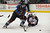 DENVER, CO. - JANUARY 24: Colorado Avalanche center Matt Duchene (9) chases after the puck as Columbus Blue Jackets defenseman Nikita Nikitin (6) falls to the ice in defense during the third period January 24, 2013 at Pepsi Center. The Colorado Avalanche  defeated the Columbus Blue Jackets 4-0.  