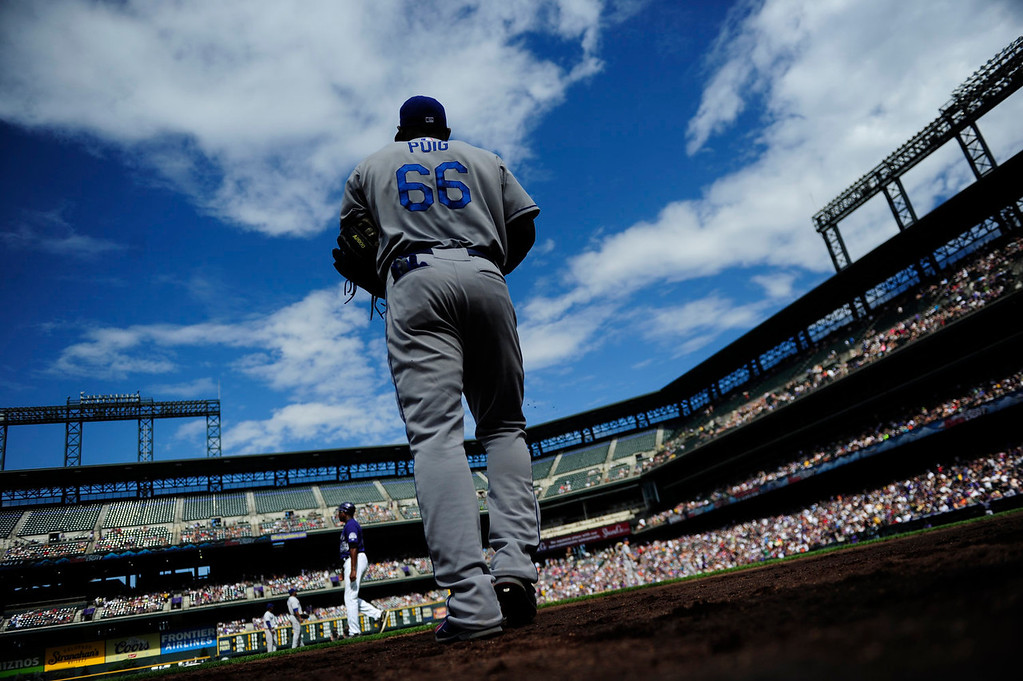 Description of . Yasiel Puig (66) of the Los Angeles Dodgers takes the field against the Colorado Rockies during the action in Denver on Monday, September 2, 2013. The Colorado Rockies hosted the Los Angeles Dodgers at Coors Field.   (Photo by AAron Ontiveroz/The Denver Post)