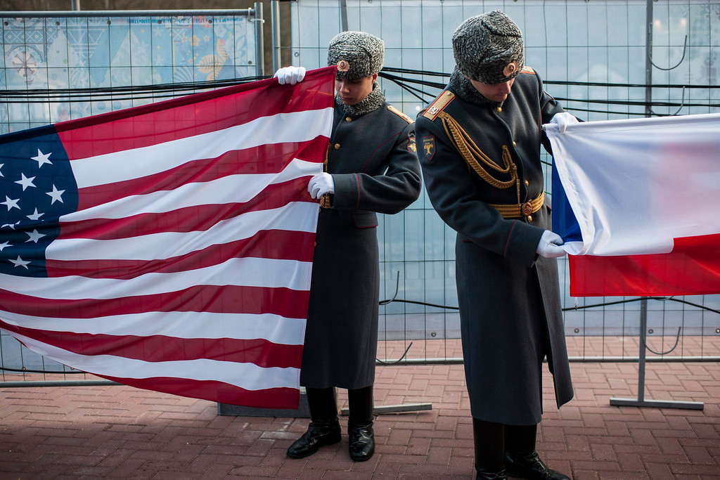 Description of . Russian soldiers prepair the flags of the USA (L) and Russia during a medal ceremony at the Winter Paralympics 2014 Sochi in Krasnaya Polyana, Russia, on March 9, 2014.  EPA/ENNIO LEANZA