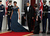 U.S. President Barack Obama (C) accidentially steps on First lady Michelle Obama's dress as they walk onto the North Portico before the arrival of British Prime Minister David Cameron and his wife Samantha Cameron the White House March 14, 2012 in Washington, DC. Cameron is on a three-day visit to the U.S. and he was expected to have talks with Obama on the situations in Afghanistan, Syria and Iran.  (Photo by Alex Wong/Getty Images)
