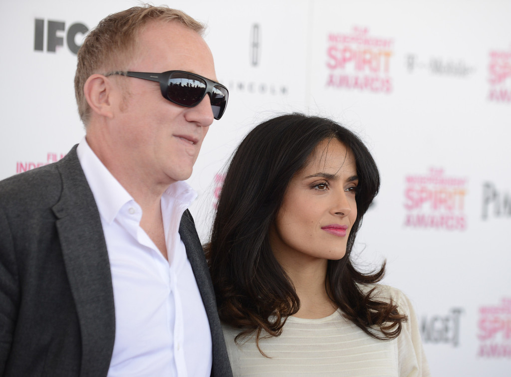 Description of . Francois-Henri Pinault, left, and actress Salma Hayek arrives at the Independent Spirit Awards on Saturday, Feb. 23, 2013, in Santa Monica, Calif.  (Photo by Jordan Strauss/Invision/AP)