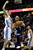 Denver Nuggets Kosta Koufos (41) guards Memphis Grizzlies Jerryd Bayless in the second quarter of a NBA game in Denver on Friday, Dec. 14, 2012.(AP Photo/Joe Mahoney)