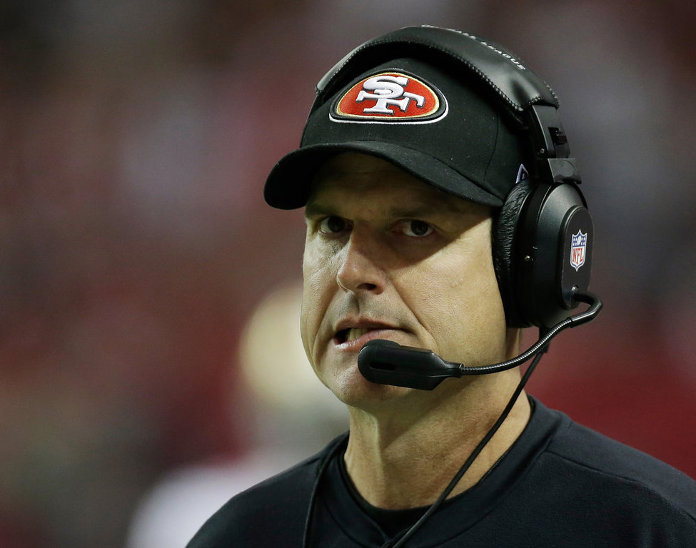 Description of . San Francisco 49ers head coach Jim Harbaugh watches his team during the first half of the NFL football NFC Championship game against the Atlanta Falcons Sunday, Jan. 20, 2013, in Atlanta. (AP Photo/Dave Martin)