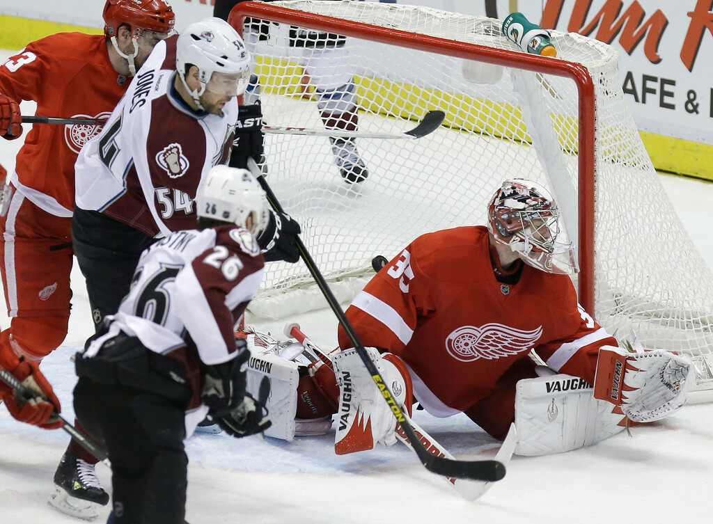 Description of . Colorado Avalanche center Paul Stastny (26) scores on Detroit Red Wings goalie Jimmy Howard (35) during the third period of an NHL hockey game in Detroit, Tuesday, March 5, 2013. Detroit won 2-1. (AP Photo/Carlos Osorio)