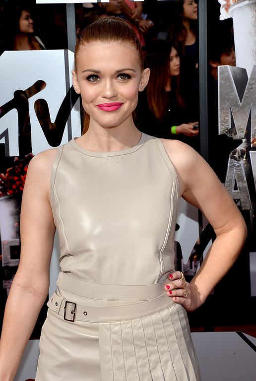 Description of . Actress Holland Roden attends the 2014 MTV Movie Awards at Nokia Theatre L.A. Live on April 13, 2014 in Los Angeles, California.  (Photo by Michael Buckner/Getty Images)