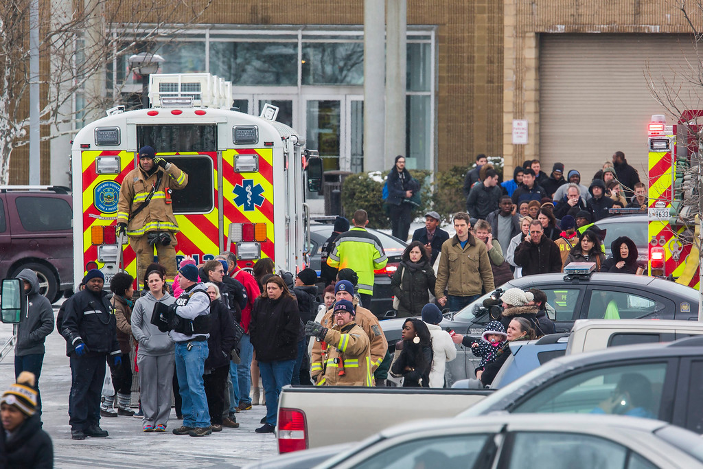 Description of . Police and fire personnel escort shoppers out of the Columbia Mall after a gunman killed three people, including himself, in the food court of the mall in Columbia, Maryland, USA, 25 January 2014.  EPA/JIM LO SCALZO