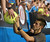 Serbia's Novak Djokovic signs autographs after victory in his men's singles semi-final match against Spain's David Ferrer on the eleventh day of the Australian Open tennis tournament in Melbourne on January 24, 2013.   PAUL CROCK/AFP/Getty Images
